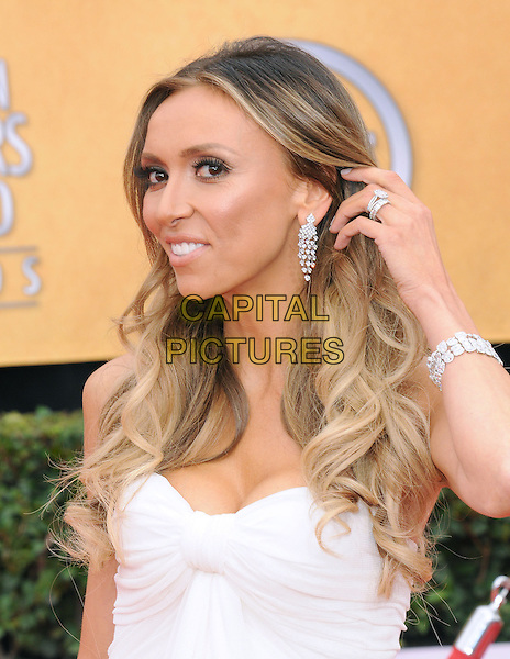 GIULIANA RANCIC.17th Annual Screen Actors Guild Awards held at The Shrine Auditorium, Los Angeles, California, USA..January 30th, 2011.arrivals SAG headshot portrait earrings dangling silver hand bracelet white  .CAP/RKE/DVS.©DVS/RockinExposures/Capital Pictures.