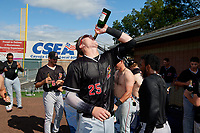 Batavia Muckdogs Sean Reynolds (25) celebrates clinching the NY-Penn League Pinckney Division Championship after a game against the Auburn Doubledays on September 2, 2019 at Falcon Park in Auburn, New York.  Batavia defeated Auburn 7-0.  (Mike Janes/Four Seam Images)