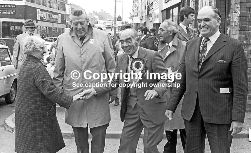 Johnny McQuade, aka John McQuade, Democratic Unionist Party, candidate,  West Belfast in the UK General Election October 1974, canvassing support on the Shankill Road. He is accompanied by DUP leader Rev Ian Paisley, left, and veteran Ulster Unionist politician, Harry West. Both McQuade &amp; West were unsuccessful. 197410090526a<br /> <br /> Copyright Image from Victor Patterson,<br /> 54 Dorchester Park, <br /> Belfast, UK, BT9 6RJ<br /> <br /> t1: +44 28 9066 1296 (from Rep of Ireland 048 9066 1296)<br /> t2: +44 28 9002 2446 (from Rep of Ireland 048 9002 2446)<br /> <br /> m: +44 7802 353836<br /> <br /> e: victorpatterson@me.com<br /> www.victorpatterson.com<br /> <br /> Please see my Terms and Conditions of Use at www.victorpatterson.com. It is IMPORTANT that you familiarise yourself with them.<br /> <br /> Images used on the Internet must be visibly watermarked i.e. &copy; Victor Patterson<br /> within the body of the image and copyright metadata must not be deleted. Images <br /> used on the Internet have a size restriction of 4kbs and will be chargeable at current<br />  NUJ rates unless agreed otherwise.<br /> <br /> This image is only available for the use of the download recipient i.e. television station, newspaper, magazine, book publisher, etc, and must not be passed on to any third <br /> party. It is also downloaded on condition that each and every usage is notified within 7 days to victorpatterson@me.com<br /> <br /> The right of Victor Patterson to be identified as the author is asserted in accordance with The Copyright Designs And Patents Act (1988). All moral rights are asserted.