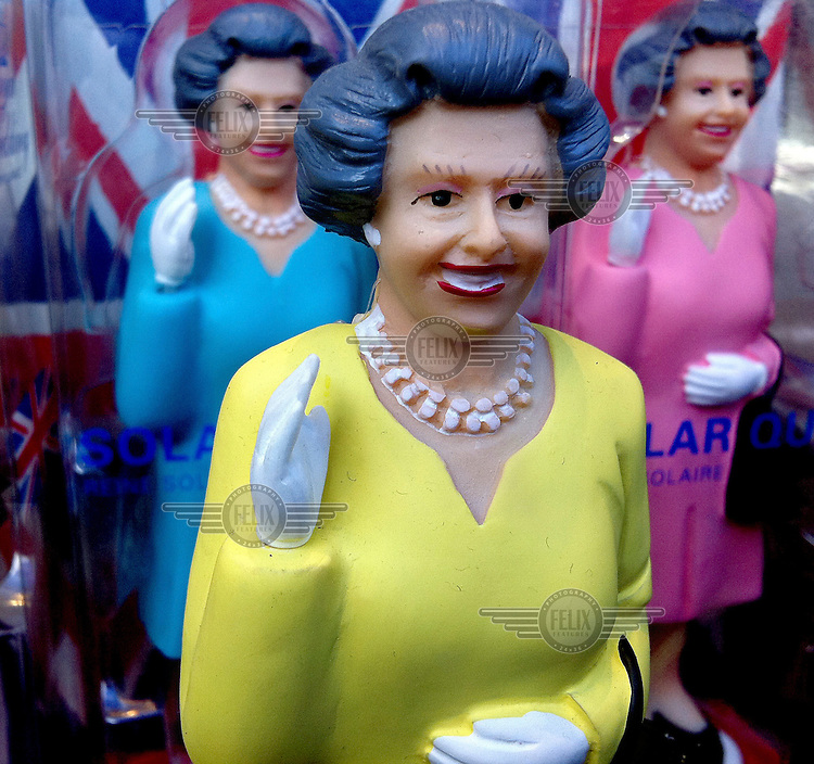 Statuettes of Queen Elizabeth II, who is celebrating her diamond jubilee in 2012 after ascending the throne in 1952, on sale in a souvenir shop in central London.  .