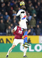 Crystal Palace's Cheikhou Kouyate heads under pressure from Burnley's Ben Mee<br /> <br /> Photographer Rich Linley/CameraSport<br /> <br /> The Premier League - Burnley v Crystal Palace - Saturday 30th November 2019 - Turf Moor - Burnley<br /> <br /> World Copyright © 2019 CameraSport. All rights reserved. 43 Linden Ave. Countesthorpe. Leicester. England. LE8 5PG - Tel: +44 (0) 116 277 4147 - admin@camerasport.com - www.camerasport.com