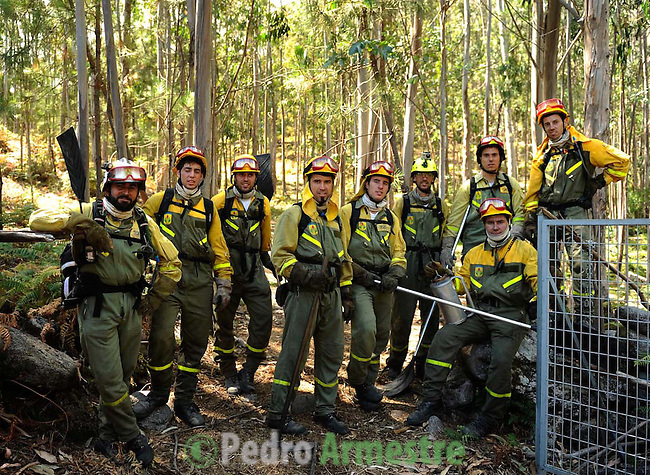 Members of the BRIF (Brigade to reinforce wildfires) of Tineo, in Asturias works around the fire area in Boiro, on August 15, 2010, near A Coruña. Pedro ARMESTRE