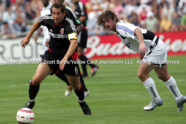 29 August 2005: Newly elected Hall of Famer and DC United Captain John Harkes dribbles past Colorado's Kyle Beckerman. The Colorado Rapids defeated DC United 6-2 at At-A-Glance Field in Oneonta, New York in the 2005 Hall of Fame Game..