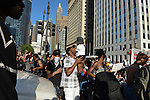 Police blocked demonstrations on State Street at Wacker Drive so supporters marching for a Citizens Police Accountability Council to provide civilian oversight of the Chicago Police Department staged a sit-in at the intersection in Chicago, Illinois on July 11, 2016.  The demonstration attracted a larger crowd on the heels of last week's racially charged police shootings captured on video of Alton Sterling in Baton Rouge, Louisiana and Philando Castile in the St. Paul suburb of Falcon Heights, Minnesota which was followed by a mass shooting of five police officers by Afghan War veteran Micah Johnson who supported radical and violent black nationalist ideology.