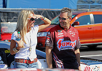 Mar. 15, 2013; Gainesville, FL, USA; NHRA pro stock driver Greg Anderson (right) with wife Kim Anderson during qualifying for the Gatornationals at Auto-Plus Raceway at Gainesville. Mandatory Credit: Mark J. Rebilas-