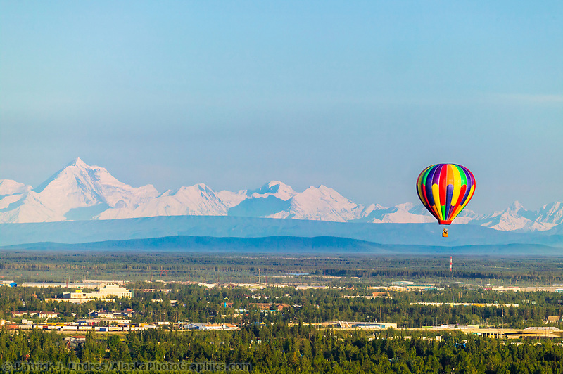 Midnight sun balloon tours, flies passengers over Fairbanks on a calm sunny evening, Mt. Hayes of the Alaska Range in the distance, Fairbanks, Alaska