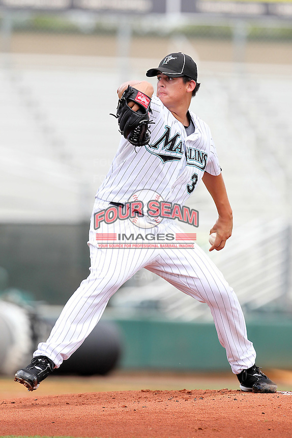 Pitcher Edgar Olmos #34 of the Florida Marlins instructional League team during a game against the Italian National Team at the Roger Dean Stadium in Jupiter, Florida;  September 27, 2011.  Italy is training in Florida for the Baseball World Cup.  (Mike Janes/Four Seam Images)