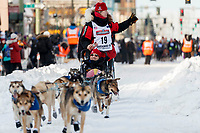 Aliy Zirkle runs down 4th avenue during the ceremonial start of the 2019 Iditarod in downtown Anchorage, Alaska on Saturday March 2.<br /> <br /> Photo by Jeff Schultz/  (C) 2019  ALL RIGHTS RESERVED