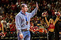 March 1, 2014: Former Husker football player and Olympian Curt Tomasevicz  waves to the fans after returning from Sochi Olympics with a Bronze medal in the four-man bobsled during a time out in the game against the Northwestern Wildcats at the Pinnacle Bank Arena, Lincoln, NE. Nebraska 54 Northwestern 47.