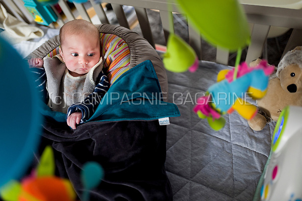 Illustration picture of a newborn baby boy surrounded by toys in his parc (Heverlee, 24/02/2017)