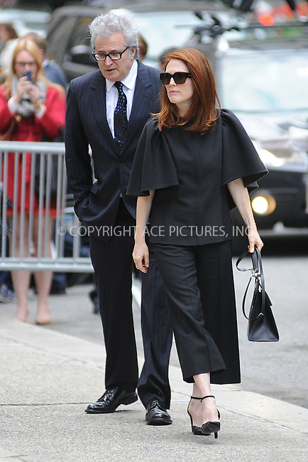 WWW.ACEPIXS.COM<br /> May 2, 2014 New York City<br /> <br /> Julianne Moore attending a memorial service for L' Wren Scott at St. Bartholomew's Church in New York City on May 2, 2014.<br /> <br /> By Line: Kristin Callahan/ACE Pictures<br /> ACE Pictures, Inc.<br /> tel: 646 769 0430<br /> Email: info@acepixs.com<br /> www.acepixs.com