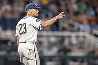 Michigan Wolverines head coach Erik Bakich (23) walks out to the mound against the Vanderbilt Commodores during Game 1 of the NCAA College World Series Finals on June 24, 2019 at TD Ameritrade Park in Omaha, Nebraska. Michigan defeated Vanderbilt 7-4. (Andrew Woolley/Four Seam Images)