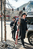 USA, Colorado, Aspen, valets take skiis out of a hotel guests car at the Hotel Jerome on Main Street