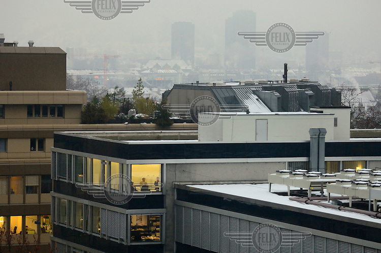 A meeting on an upper floor of the Zurich offices of a Liechtenstein bank, with the city behind. The Swiss banking industry holds an estimated 4,000 billion Swiss Francs (USD 4,240 billion) in assets, more than half of it foreign, including CHF 880 billion in undeclared European assets alone, benefiting from the country's famous banking secrecy laws...