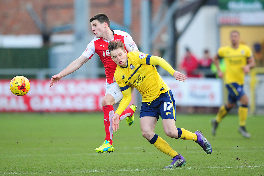 Fleetwood Town's Bobby Grant vies for possession with Scunthorpe United&rsquo;s Conor Townsend<br /> <br /> Photographer Chris Vaughan/CameraSport<br /> <br /> Football - The Football League Sky Bet League One - Fleetwood Town v Scunthorpe United  - Saturday 20th February 2016 - Highbury Stadium - Fleetwood    <br /> <br /> &copy; CameraSport - 43 Linden Ave. Countesthorpe. Leicester. England. LE8 5PG - Tel: +44 (0) 116 277 4147 - admin@camerasport.com - www.camerasport.com