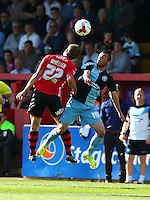 Michael Harriman of Wycombe Wanderers challenges for the ariel ball with David Wheeler of Exeter City during the Sky Bet League 2 match between Exeter City and Wycombe Wanderers at St James' Park, Exeter, England on 26 September 2015. Photo by Pinnacle Photo Agency.