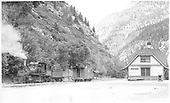 Locomotive #316 takes on water in Ouray, CO sometime in 1942. Located about 20 miles north of Silverton, Ouray was nestled deep in the San Juan Mountains. Getting a northbound train up to the small town was no easy task, though it provided a scenic experience that was nothing short of breathtaking. Travelers can see this today via the Million Dollar Highway.<br /> D&amp;RGW  Ouray, CO  Taken by Perry, Otto C. - 2/7/1942