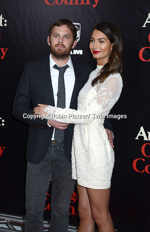 "Caleb Followill and wife Lily Aldridge  attend the New York Premiere of ""August: Osage County"" on December 12, 2013 at the Ziegfeld Theatre in New York City."