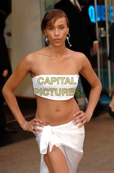 "JAVINE HYLTON.""The Island"" European film premiere at the Odeon cinema, Leicester Square, London.7 August 2005.half length hands on hips boob tube belly stomach midriff tattoo cherub angel.www.capitalpictures.com.sales@capitalpictures.com.©Capital Pictures"