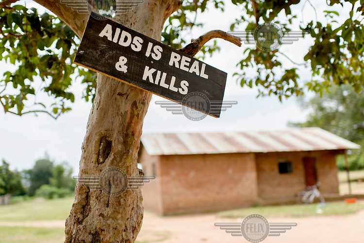 A sign nailed to a tree reads: 'AIDS is real and kills' at Aputiri Primary School.