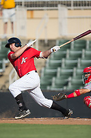 Jake Burger (31) of the Kannapolis Intimidators follows through on his swing against the Hagerstown Suns at Kannapolis Intimidators Stadium on July 9, 2017 in Kannapolis, North Carolina.  The Intimidators defeated the Suns 3-2 in game two of a double-header.  (Brian Westerholt/Four Seam Images)