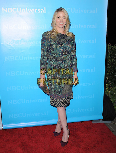 Christina Applegate.at The NBC Universal Press Tour All-Star Party, The Athenaeum, Pasadena, California, USA, January 6th 2012..full length green print patterned dress  purple shoes clutch bag                                                                 .CAP/RKE/DVS.©DVS/RockinExposures/Capital Pictures.