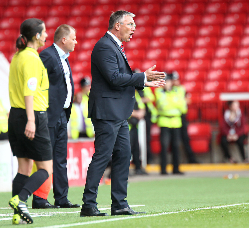 Sheffield United manager Nigel Adkins shouts instructions to his team from the dug-out<br /> Photographer Rich Linley/CameraSport<br /> <br /> Football - The Football League Sky Bet League One - Sheffield United v Blackpool - Saturday 22nd August 2015 - Bramall Lane - Sheffield<br /> <br /> &copy; CameraSport - 43 Linden Ave. Countesthorpe. Leicester. England. LE8 5PG - Tel: +44 (0) 116 277 4147 - admin@camerasport.com - www.camerasport.com