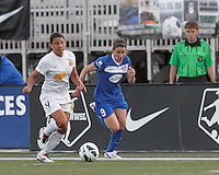 Western New York Flash forward Samantha Kerr (4) brings the ball forward as Boston Breakers midfielder Heather O'Reilly (9) closes. In a National Women's Soccer League Elite (NWSL) match, the Boston Breakers (blue) tied Western New York Flash (white), 2-2, at Dilboy Stadium on June 5, 2013.