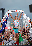 KAILUA-KONA, HI - OCTOBER 12:  Mirinda Carfree of Australia finishes in first place during the 2013 Ironman World Championship on October 12, 2013 in Kailua-Kona, Hawaii. (Photo by Donald Miralle) *** Local Caption ***