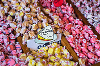 Taffy flavor bins in a candy store.