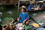 Bangkok - Thailand, February 25, 2012 -- Boat vendor offering snacks at the floating market of Ladmayom; people, commerce, small scale business, infrastructure, economy -- Photo © HorstWagner.eu