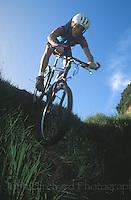 Mountain Biker charging steep drop, Mendocino California