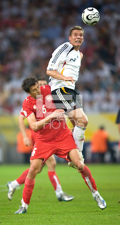 Lukas Podolski of Germany in action against Jacek Bak of Poland at FIFA World Cup Stadium, Dortmund, Germany, June 14, 2006.