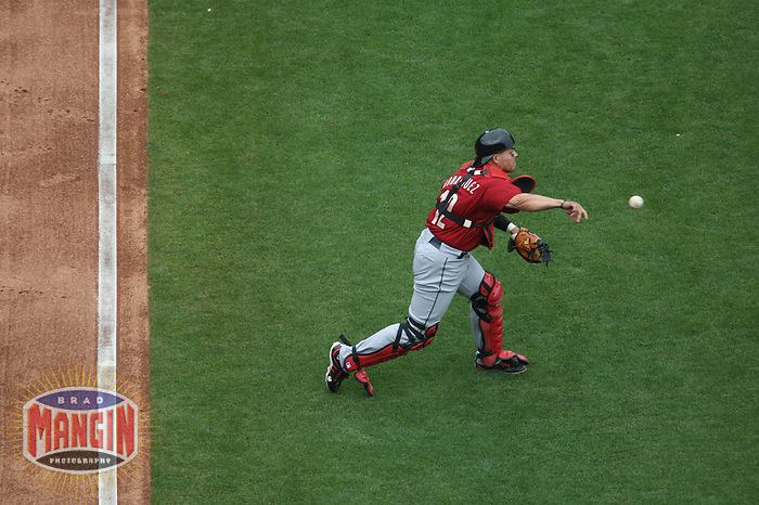 SAN FRANCISCO - JULY 5:  Ivan Rodriguez #12 of the Houston Astros fields a swinging bunt and throws to first base against the San Francisco Giants during the game at AT&T Park on July 5, 2009 in San Francisco, California. Photo by Brad Mangin