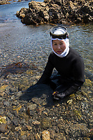 Japan, Mie Prefecture, Osatsu, Toba City. Family of Ama divers. Third generation women Ama free divers, well into their 70's. Once pearl divers, they now collect seaweed, conch, lobster, abalone, shellfish. Shore diving for shellfish. The women are considered better divers because of their body fat. Model released