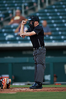 Home plate umpire Cas Cousins calls a strike on a batter during an Arizona League game between the AZL Giants Orange and the AZL Cubs 1 on July 10, 2019 at Sloan Park in Mesa, Arizona. The AZL Giants Orange defeated the AZL Cubs 1 13-8. (Zachary Lucy/Four Seam Images)
