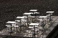 Deserted tables and chairs out of season on Brighton beach, South Coast,  England, United Kingdom