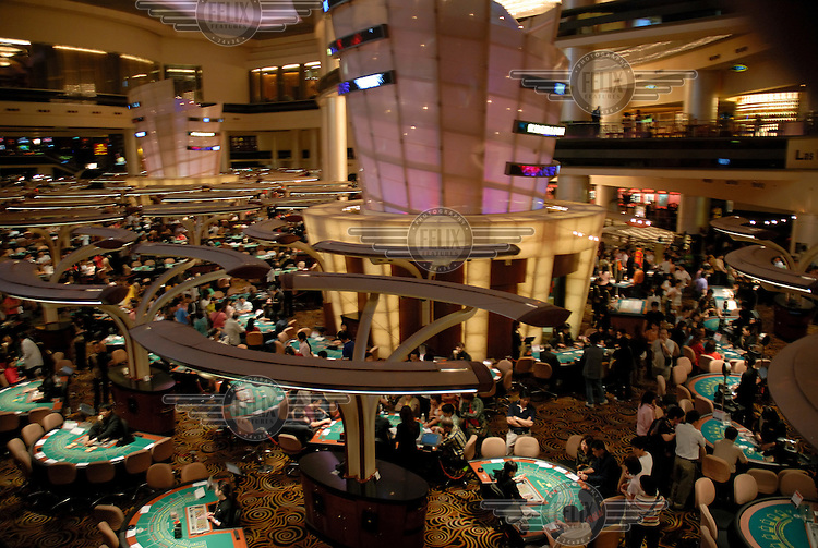Tables in the Sands casino, which has the largest casino floor in the world. Macau, currently the only part of China to allow gambling, has witnessed a casino boom in recent years which has seen it become the world's top gambling destination in terms of revenue.Photo: Dermot Tatlow/Panos Pictures/Felix Features