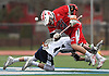 Michael Carere #13 of Connetquot (helmet #38), front, and Cole Pillion #4 of Huntington battle for control of a faceoff during a Suffolk County varsity boys lacrosse game at Huntington High School on Friday, April 7, 2017. Connetquot rallied from a 12-10 deficit early in the fourth quarter to win 15-14.