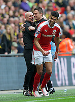 Caretaker Head Coach Paul Heckingbottom of Barnsley celebrates with his assistant after their win by 3-2 in the Johnstone's Paint Trophy Final match between Oxford United and Barnsley at Wembley Stadium, London, England on 3 April 2016. Photo by Alan  Stanford / PRiME Media Images.
