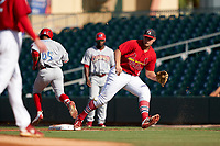 Palm Beach Cardinals first baseman Luken Baker (47) fields a throw as Raul Rivas (65) runs through the bag during a Florida State League game against the Clearwater Threshers on August 10, 2019 at Roger Dean Chevrolet Stadium in Jupiter, Florida.  Clearwater defeated Palm Beach 11-4.  (Mike Janes/Four Seam Images)