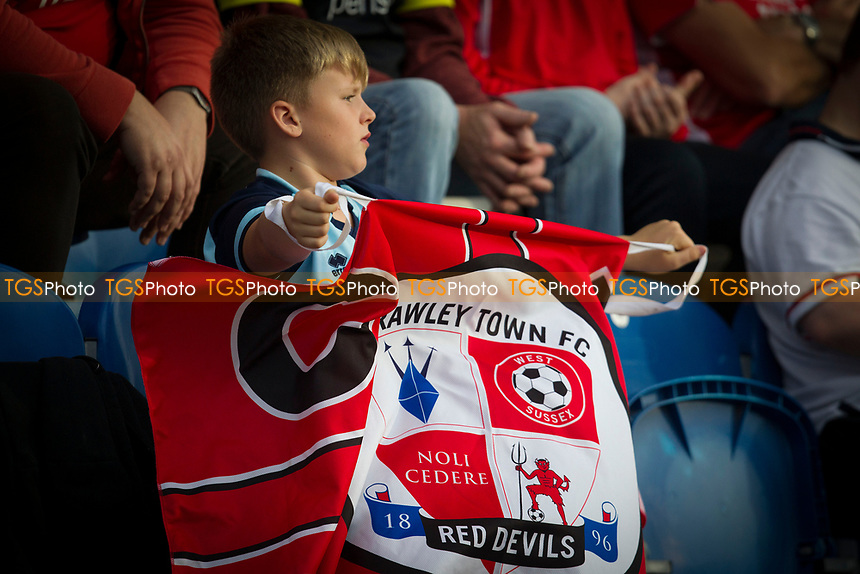 A young visiting fan quietly urges his team on during Colchester United vs Crawley Town, Sky Bet EFL League 2 Football at the JobServe Community Stadium on 13th October 2018
