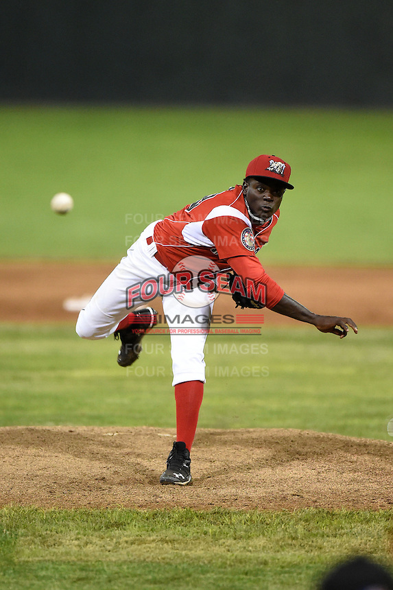 Batavia Muckdogs pitcher Juancito Martinez (29) delivers a pitch during a game against the Auburn Doubledays on June 14, 2014 at Dwyer Stadium in Batavia, New York.  Batavia defeated Auburn 7-2.  (Mike Janes/Four Seam Images)