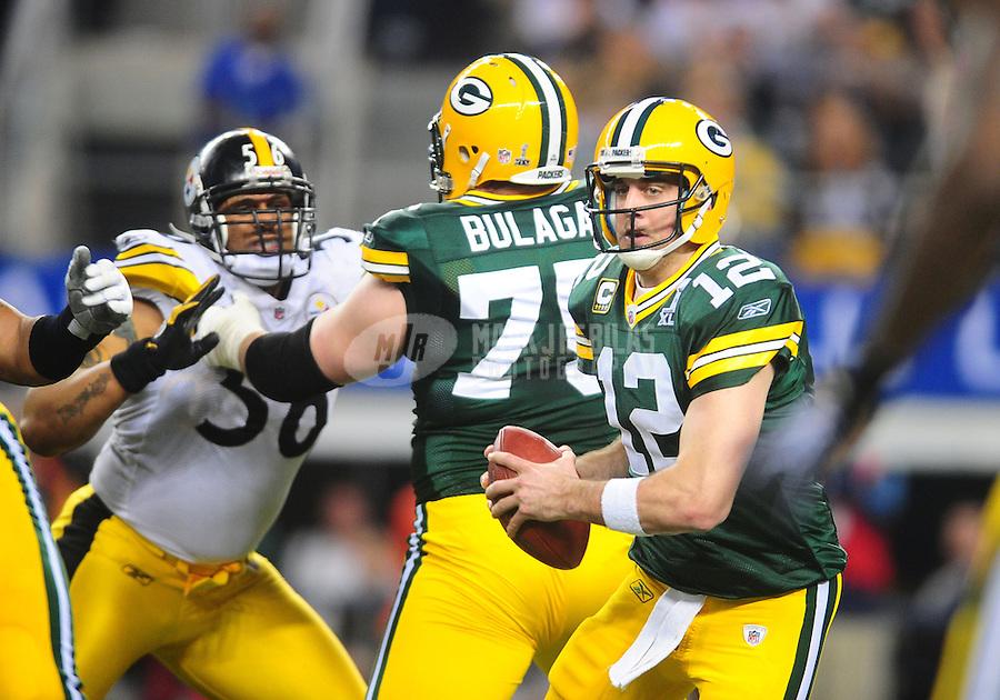Feb 6, 2011; Arlington, TX, USA; Green Bay Packers quarterback Aaron Rodgers (12) against the Pittsburgh Steelers in Super Bowl XLV at Cowboys Stadium.  Mandatory Credit: Mark J. Rebilas-