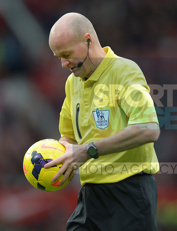 Referee Lee Mason checks the match ball - Barclays Premier League - Manchester Utd  vs Stoke City  - Old Trafford Stadium - Manchester - England - 26/10/13 - Picture Simon Bellis/Sportimage