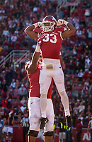 Hawgs Illustrated/BEN GOFF <br /> David Williams (33), Arkansas running back, and Johnny Gibson, Arkansas right guard, celebrate after Williams scored a touchdown in the second quarter against Missouri Friday, Nov. 24, 2017, at Reynolds Razorback Stadium in Fayetteville.