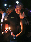 A Carson City Sheriff's deputy attends a candlelight vigil in Carson City, Nev., on Saturday, Aug. 15, 2015. Hundreds of residents came out to show their support for the family and department after a deputy was killed in the line of duty early Saturday morning after responding to a domestic violence call. <br /> Photo by Cathleen Allison
