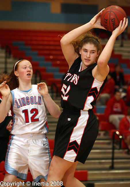 SIOUX FALLS, SD - January 9:  Breanna Janovy #52 of Sturgis pulls in a rebound over Caiti Slattery #12 of Lincoln in the first half of their game Friday night at Lincoln. (Photo by Dave Eggen/Inertia)