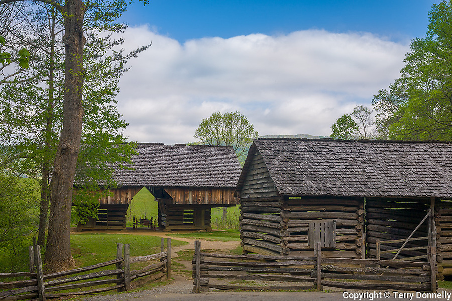 """Great Smoky Mts. National Park, TN/NC<br /> View of a cantilever barn and a log corn crib with a split rail fence at """"The Tipton place"""" farm site in Cades Cove"""