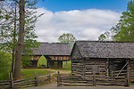 Great Smoky Mts. National Park, TN/NC<br /> View of a cantilever barn and a log corn crib with a split rail fence at &quot;The Tipton place&quot; farm site in Cades Cove